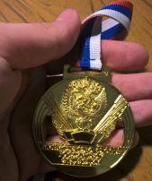 Золото Чемпиона по американскому футболу_вид с обратной стороны